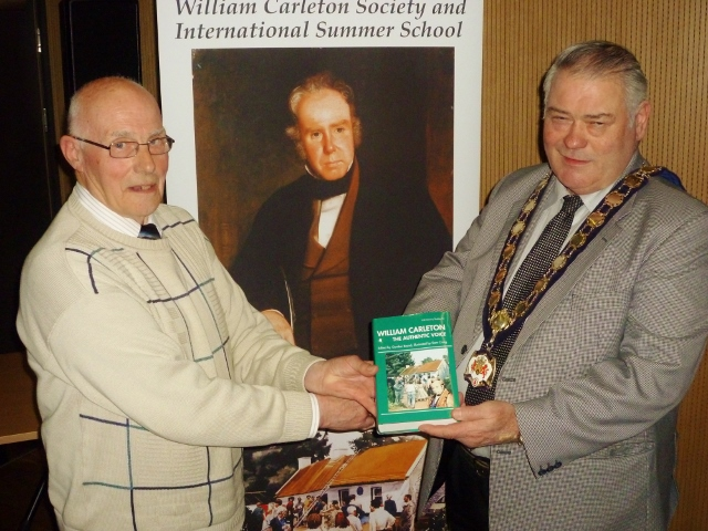 Pat Boyle presents a copy of The Authentic Voice to Mayor of Dungannon Cllr Phelim Gildernew
