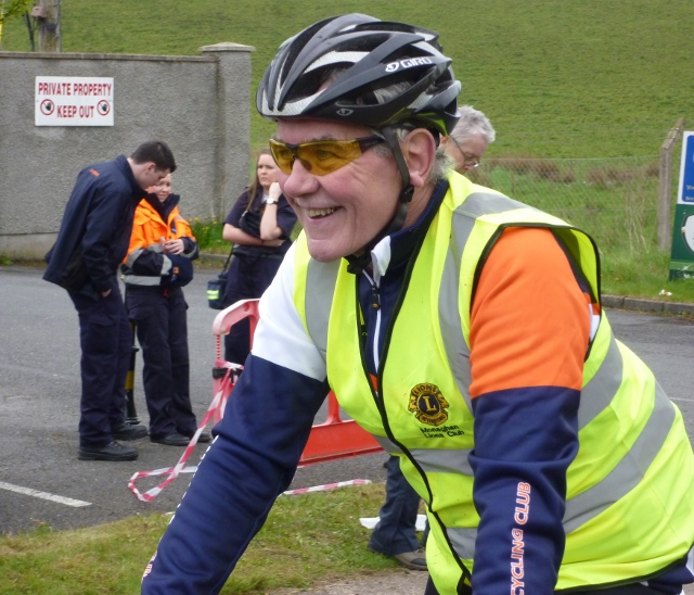 Volunteer helping with marshalling along the 10k route