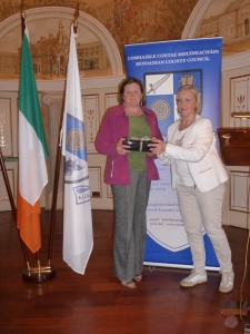 Tydavnet Group organiser Sheila McKenna is presented with a gift by Mayor of Geel Vera Celis