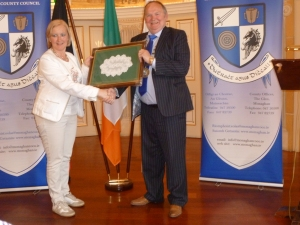 Monaghan Mayor Hugh McElvaney presents a gift of Clones Lace to Geel Mayor Vera Celis