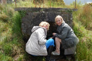 Geel Mayor Vera Celis & Cllr Nadine Laeremans collect water from St Dympna's Well, Tydavnet Photo: © Patricia Cavanagh