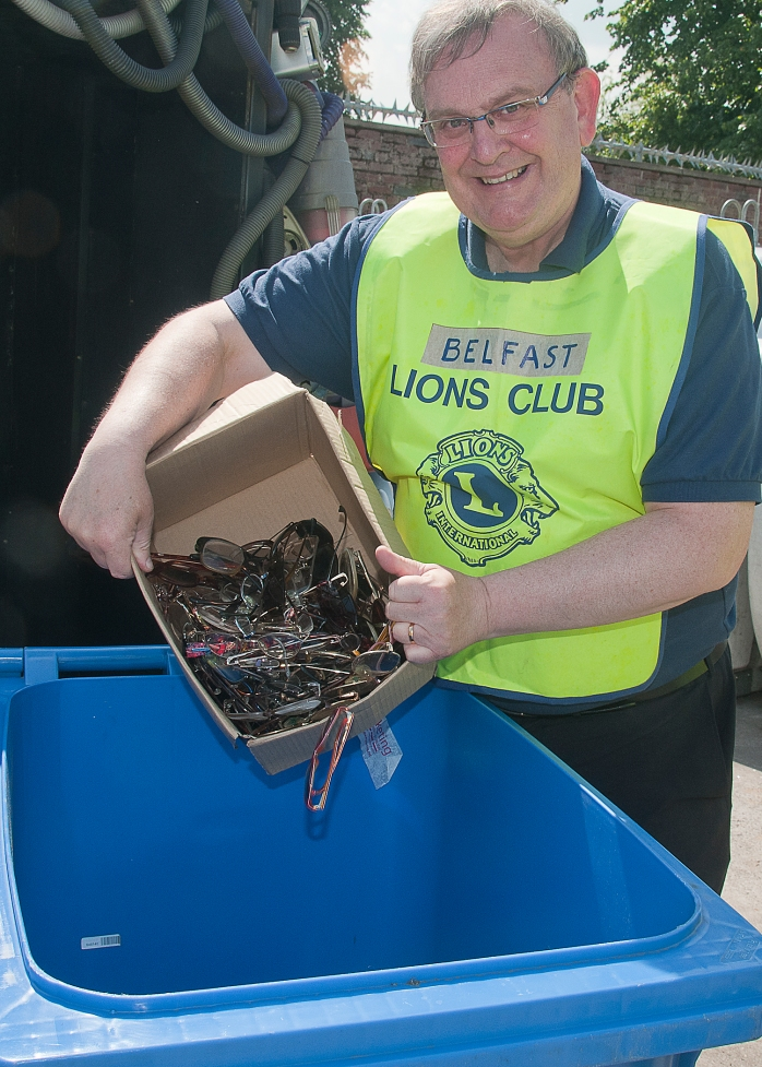 President Belfast Lions Club, Michael Fisher, recycling spectacles at the Ormeau depot