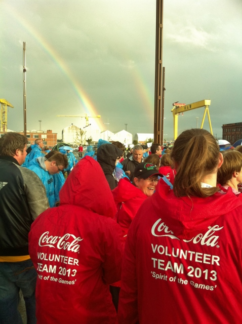 The spirit of the volunteers is evident as a double rainbow appears
