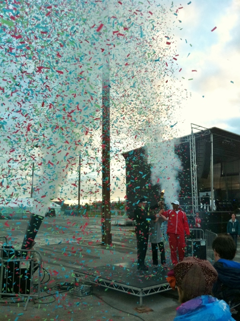 Confetti cannons explode and the games flame is shrouded in colour Photo: © Michael Fisher