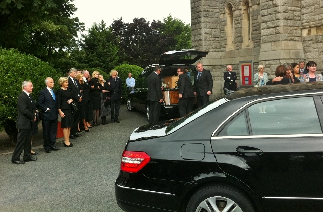 Members of the Davy family await the arrival of the remains of Kevin Feeney