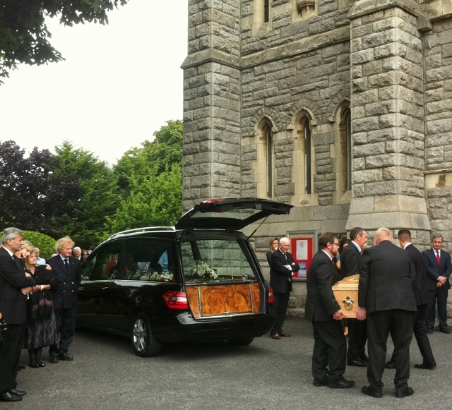 Remains of Kevin Feeney arrive at Sacred Heart Church