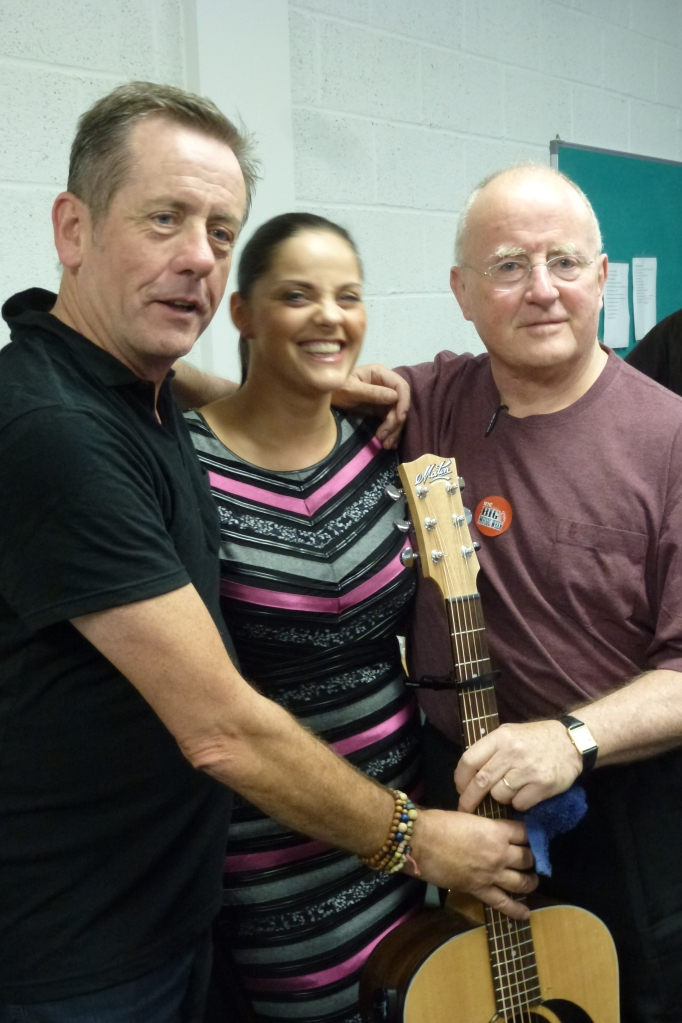 Celine Byrne with Luka Bloom and his brother Christy Moore in Newbridge: up the Lilywhites!  Photo: © Michael Fisher