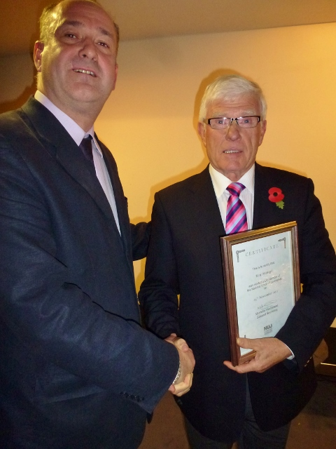 IEC Cathaoirleach Gerry Curran presents Ray Managh with his life membership award Photo: © Michael Fisher