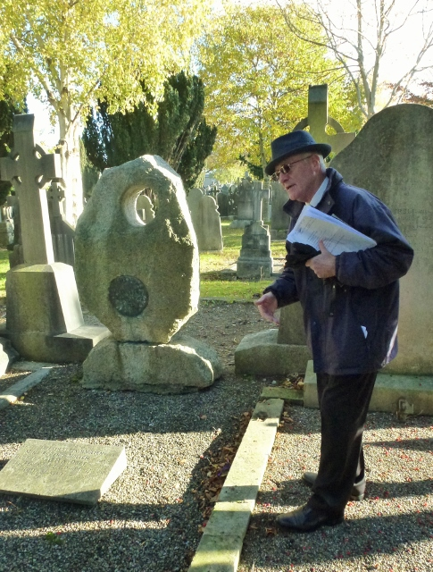 Tour Guide Paddy Gleeson points out Brendan Behan's Grave  Photo: © Michael Fisher
