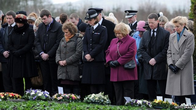 Families and relatives at Dryfesdale cemetery, Lockerbie  Photo: Getty Images ex BBC News
