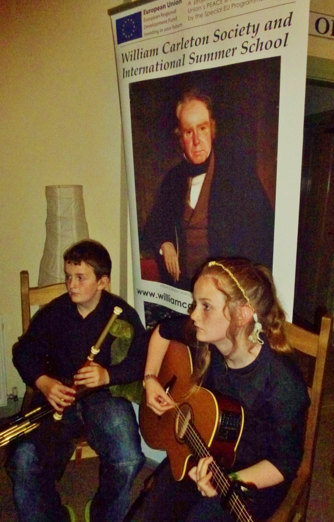 Peter Mc Kenna (uilleann pipes) & his sister (guitar) at Somers café Fardross  Photo: © Michael Fisher