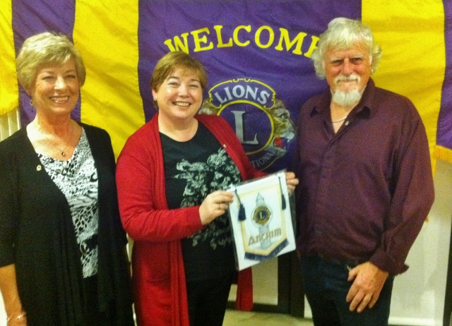 Zelda & Ray Jones Vera Lions Club are presented with an Antrim Lions pennant by Lion President Karen McCormack  Photo: © Michael Fisher