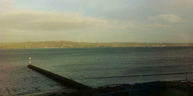 View from train of coastal path near Holywood   Photo: © Michael Fisher