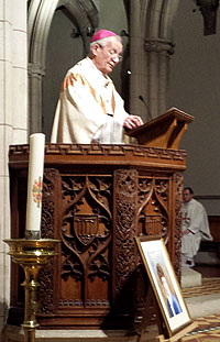 Archbishop Peter Smith inducts Mgr Hudson as Parish Priest Photo: Southward Archdiocese website