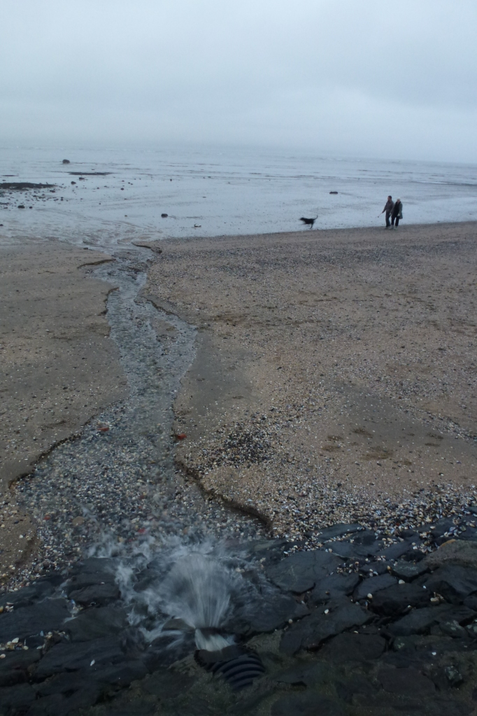Stream flowing into the sea along the coastal path  Photo: © Michael Fisher