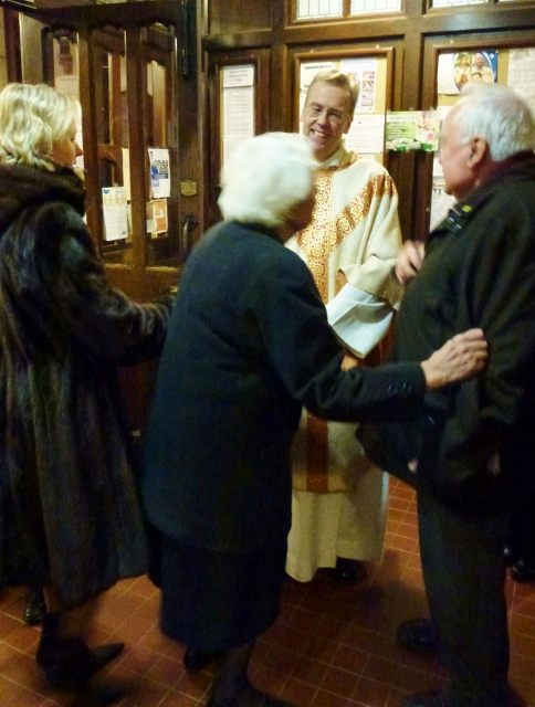 Mgr Nick Hudson is congratulated by parishioners after his first Mass as new PP  Photo: © Michael Fisher