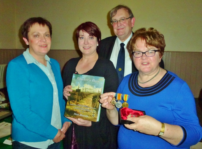Heather Stirrat, Marie McKenna, Michael Fisher and Ruby Heasty with the three WW1 medals Photo: © Evelyn Fisher