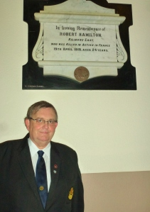 Michael Fisher at the plaque for Robert Hamilton at St Dympna's Church, Ballinode Photo: © Evelyn Fisher