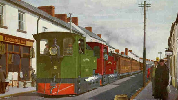 Clogher Valley Railway train in Main Street Fivemiletown: from painting by Viktor Welch