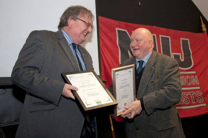 Michael Fisher presented with NUJ life membership by Seamus Dooley  Photo:  © Kevin Cooper