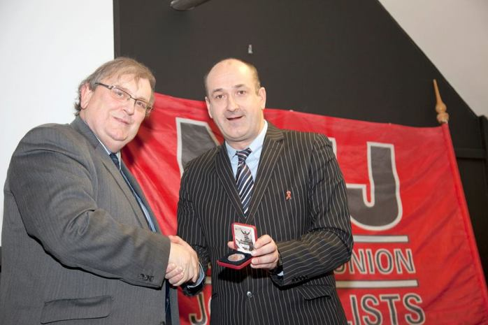 Michael Fisher presented with 1913 lockout centenary coin by Gerry Curran  Photo:  © Kevin Cooper
