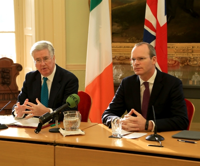 Michael Fallon M.P., British Defence Secretary and Irish Defence Minister Simon Coveney T.D. sign the memorandum  Photo:  Department of Defence
