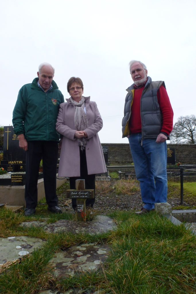 Patsy McKenna, Rosaleen Kearney and Art Agnew at Patrick Kavanagh's grave, Inniskeen  Photo:  © Michael Fisher