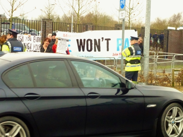 Taoiseach's car passes anti-water tax protestors outside Campus gates  Photo: © Michael Fisher