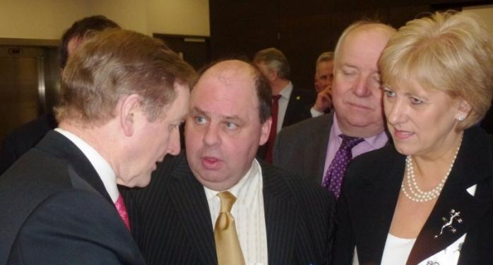 Taoiseach Enda Kenny TD talking to Brendan Ó Dufaigh Principal Coláiste Oiriall and Arts Minister Heather Humphreys TD  Photo: © Michael Fisher