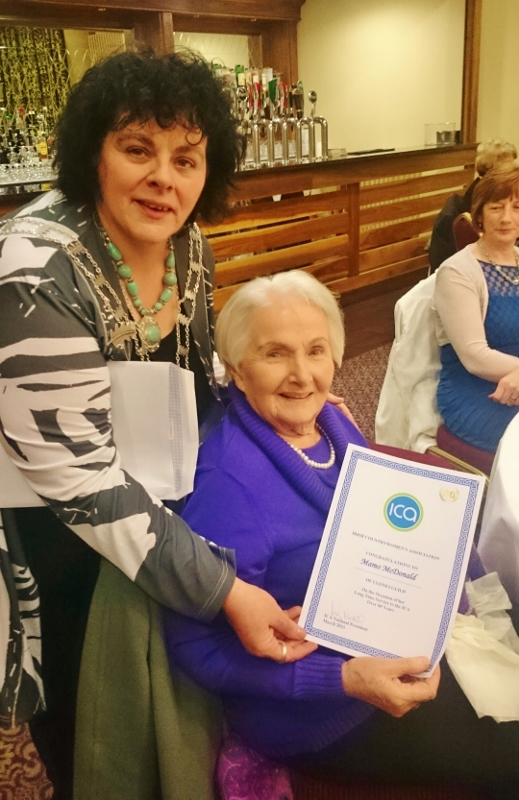 ICA National President Liz Wall presents a certificate for 60 years' membership to one of her predecessors, Mamo McDonald from Clones guild Photo:  © Michael Fisher