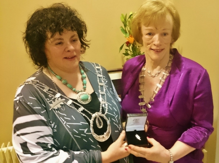 ICA National President Liz Wall presents Patricia Cavanagh with a silver oak leaf brooch to mark her three years as Monaghan Federation President  Photo:  © Michael Fisher