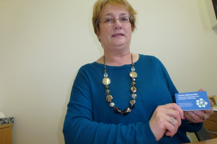 Maeve Montgomery, Alzheimer Society, with dementia card at Carrickmacross Wokhouse  Photo: © Michael Fisher