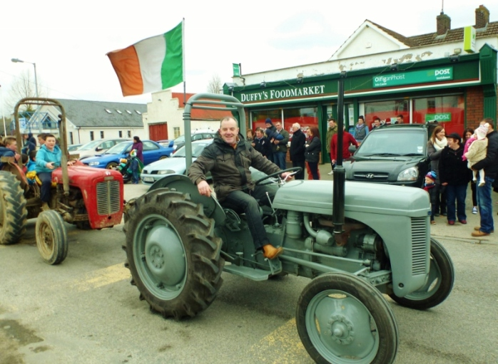 Monaghan SF Cllr Noel Keelan flying the national flag on his vintage tractor in Inniskeen Photo:  © Michael Fisher
