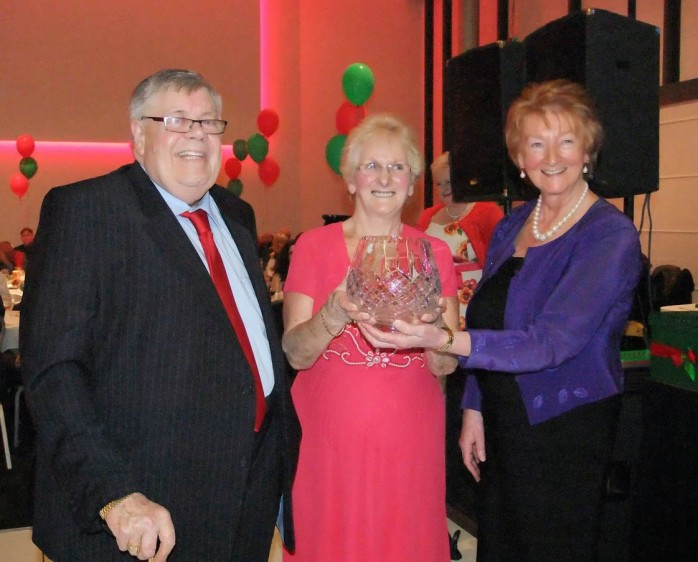 Tommy McKenna, Carrickmacross, receives a commenorative crystal bowl with his award from the Manchester Mayo Association President Marcella Wilkinson and Chairperson Patricia Gallagher. Photo: © Bernie O'Brien