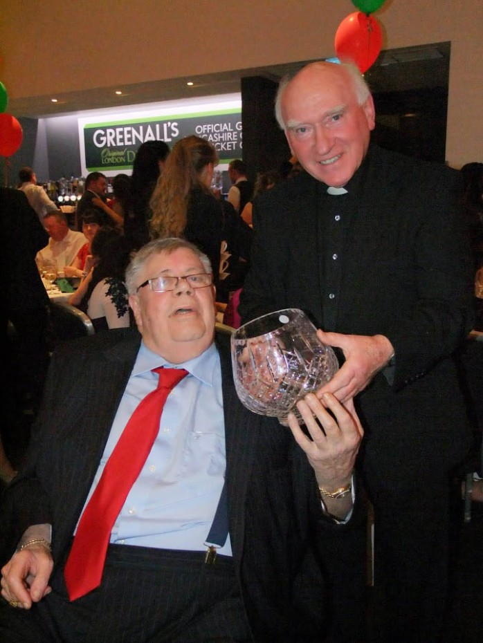 Tommy McKenna, Carrickmacross, is congratulated by Manchester Monaghan Association President, Fr Paddy McMahon from Emyvale. Photo: © Bernie O'Brien.