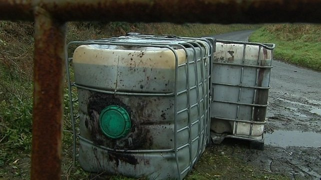 Containers filled with toxic diesel sludge abandoned at a roadside in Co. Monaghan  Photo: RTÉ News 2012