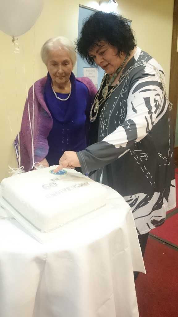 ICA National President Liz Wall cuts the 60th anniversary cake (by Mary Reilly Rockcorry) with one of her predecessors Mamo McDonald from Clones  Photo:  © Michael Fisher