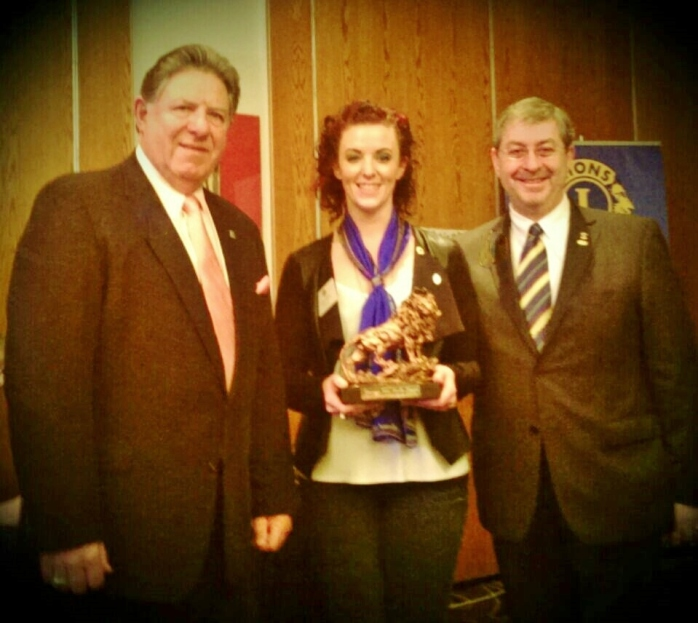 Lesley Goggins, Monaghan Lions Club, is congratulated on receiving her Emerging Lion Award 2015 by Past International President Lion Jim Ervine and Past International Director Lion Phil Nathan