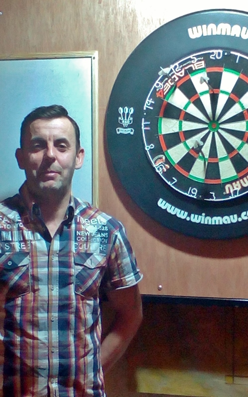 Hughie Martin, Inniskeen, after his perfect nine in the darts competition at Aughnamullen Social Centre, Co. Monaghan