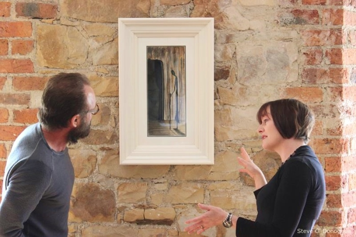 Local artist Orlagh Meegan Gallagher shows Sting her work 'The Last Resort' on permanent display at Carrickmacross Workhouse, before presenting him with a smaller work, 'Mary Murphy', based on the original. Photo © Steve O'Donoghue/Carrickmacross Workhouse 2015