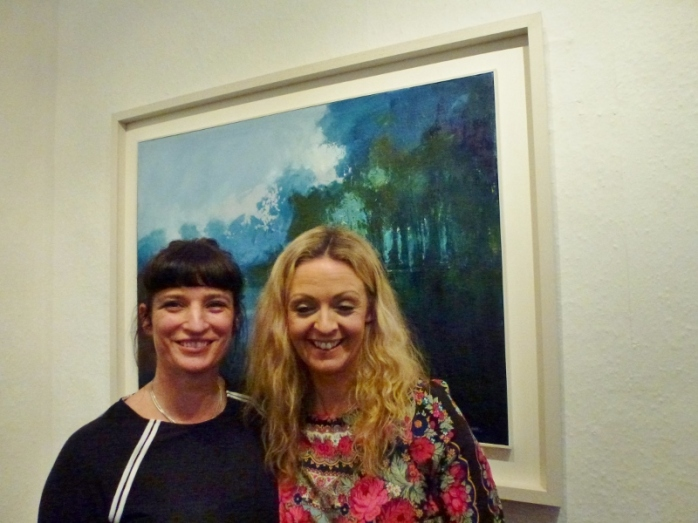 Doorway Gallery owners Deirdre Carroll and Denise Donnelly with Kate Beagan's painting 'Reflection'  Photo:  © Michael Fisher
