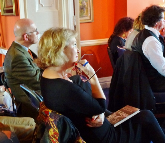 Mary O'Donnell listens to Dr James Heaney Photo © Michael Fisher