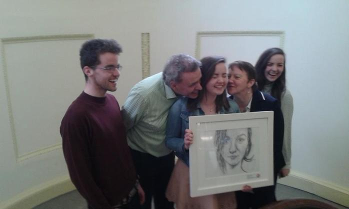Frances Treanor, Tydavnet (middle), is congratulated by  her parents Sean and Anne, her brother Ronan (left) and twin sister Maeve (right). Photo: facebook