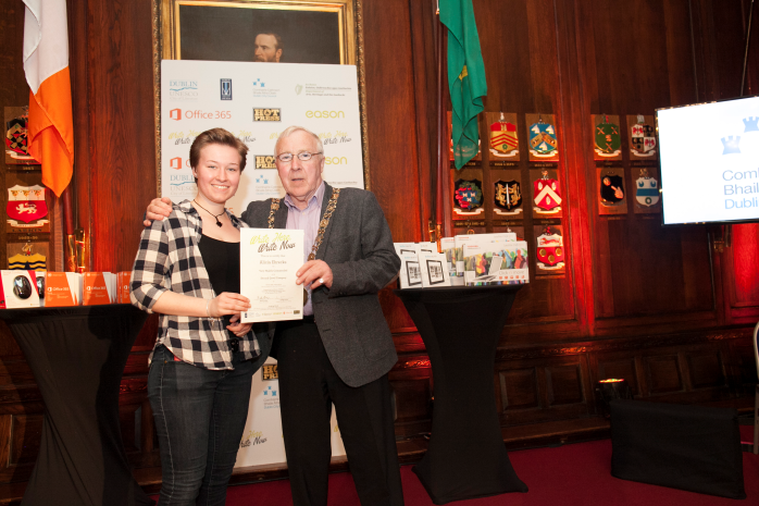 Alicia Ehrecke of Inver College, Carrickmacross, receives a 'Very Highly Commended' Hot Press award for her short story from the Lord Mayor of Dublin, Cllr Christy Burke Photo: Hot Press