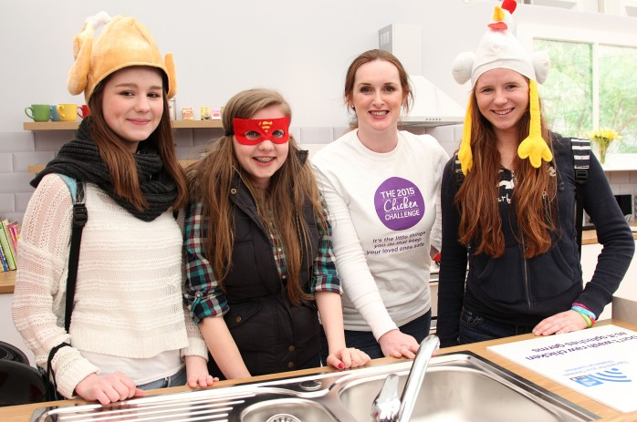 Taking the 'Chiecken Challenge' at Balmoral Show: (L-R) Lynsey Forde, Laura Louise Reay and Aoife Murphy from Monaghan town alongside (centre) Elaine Donaghy of the NI Food Standards Agency ©Brian Thompson Photography
