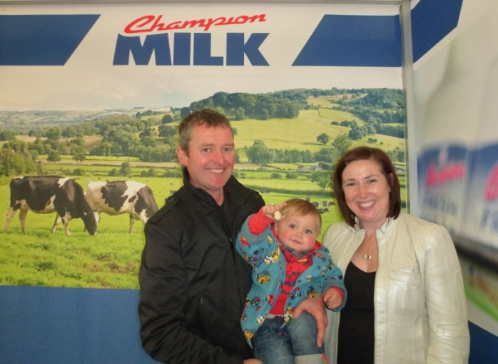 The McMahons including one year-old Henry at Town of Monaghan Co-Op stand Judging in the cattle ring at Balmoral Show Photo:  © Michael Fisher