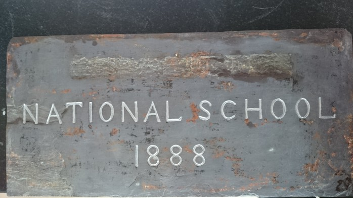 Stone plaque with name of school scratched out during WWII Photo:  © Michael Fisher