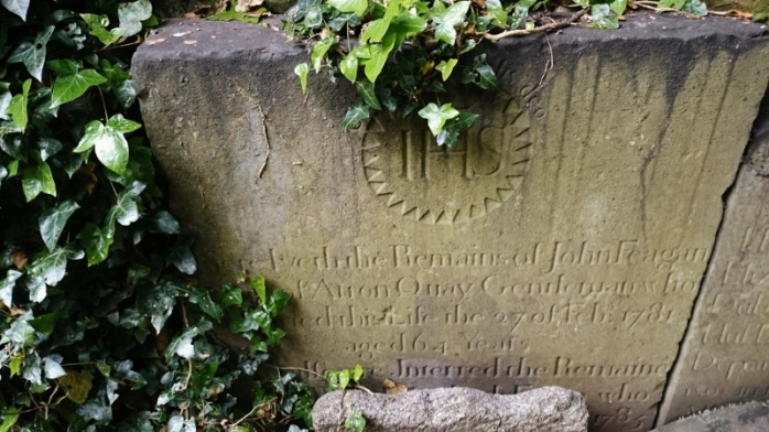 Headstone with 'IHS' sign for grave of nJohn Feagan, Gentleman of Arron (Arran) Quay, Dublin, in St Kevin's Park.  Photo:  © Michael Fisher