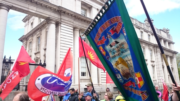 Belfast Trades' Union Council banner being carried past government buildings  Photo:  © Michael Fisher