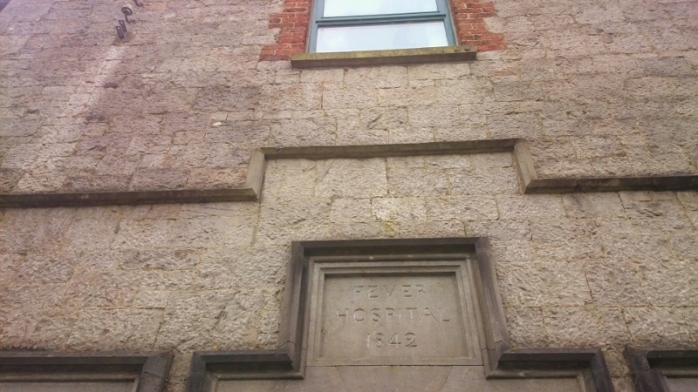 Stone Plaque above front entrance at former Fever Hospital, Carrickmacross, showing construction date 1842   Photo:  © Michael Fisher